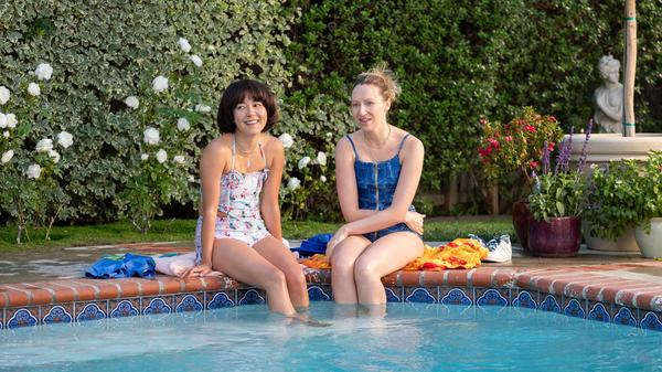 Maya (Maya Erskine) and Anna (Anna Konkle) survive a pool party and a lot of other challenges in the second season of Hulu's <em>PEN15</em>.