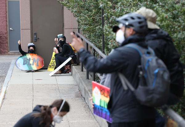 Protesters sat against or stood outside all doors at City Hall.