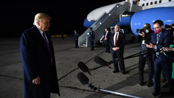 President Trump reacts to the news of Justice Ruth Bader Ginsburg's death on Friday at Bemidji Regional Airport in Minnesota. He told reporters on the tarmac after his rally that he learned the news from them.
