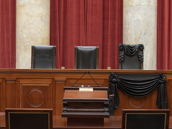 The bench draped for the death of Justice Ruth Bader Ginsburg.
