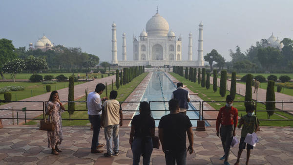 Tourists visit the Taj Mahal on Monday, when it reopened after being closed for more than six months due to the coronavirus pandemic.