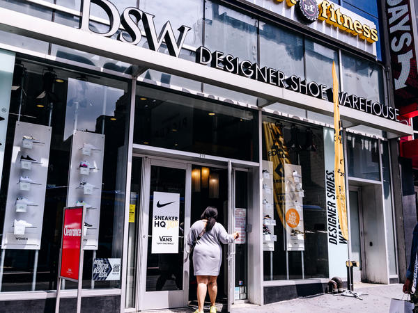 A shopper enters a DSW store in New York City. DSW is partnering with Hy-Vee, a Midwest supermarket chain, to offer shoes in grocery stores.