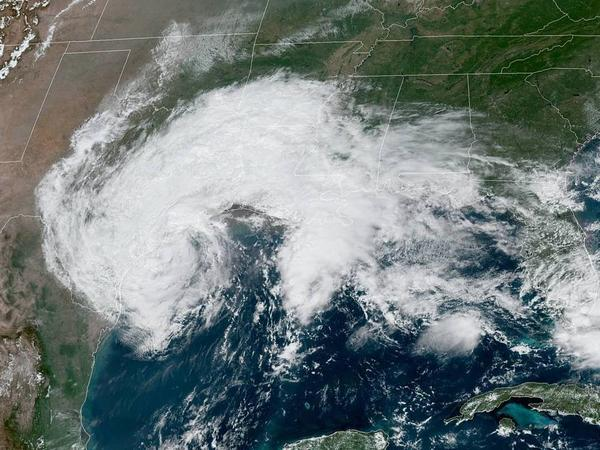 Tropical Storm Beta is expected to hug the coastline as it pours rain on the Gulf Coast of Texas and Louisiana.