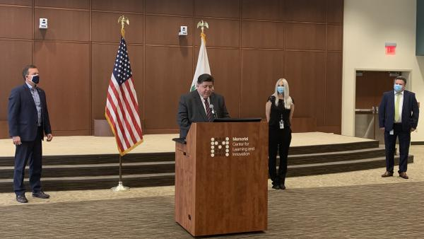 Gov. JB Pritzker touts the state's COVID-19 testing capacity at a news conference in Springfield.