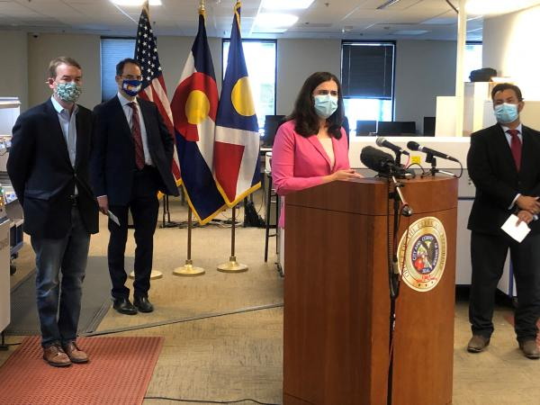 Colorado Secretary of State Jena Griswold defends mail-in ballots during a press conference Monday in downtown Denver.