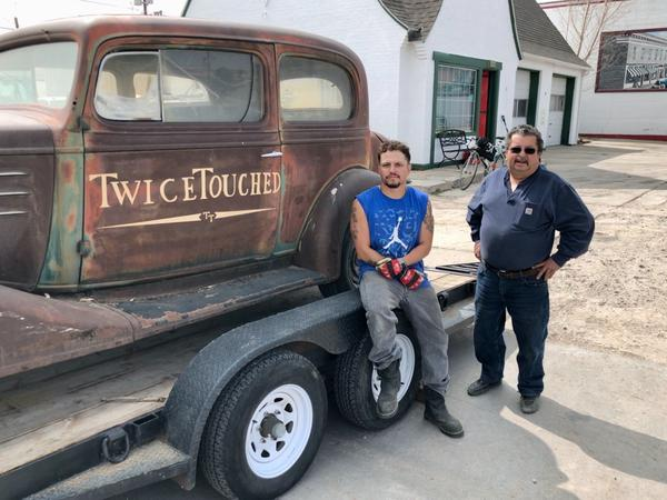 """Lucas Medain, left, and his cousin Jesus """"Eddie"""" Archuleta in front of a 1930s-era Chevrolet Archuleta just purchased."""