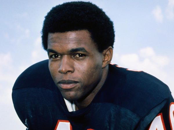 Gale Sayers, who held or shared 12 NFL records when he retired, has died at age 77. He famously dedicated an award to his friend and teammate Brian Piccolo.