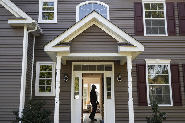 A man tours his new home (John Minchillo/AP)