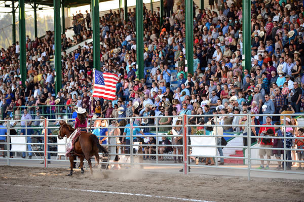 Fans stand for the national anthem at the Northwest Montana Fair and Rodeo at the Flathead County Fairgrounds in Kalispell, Montana, on Aug. 22, 2020. (Casey Kreider/Daily Inter Lake)