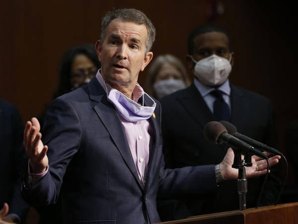 Virginia Gov. Ralph Northam, shown here at a news conference in June, has tested positive for the coronavirus.