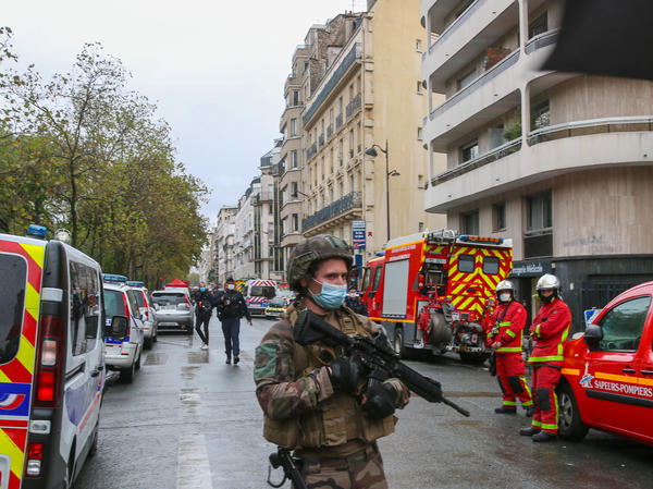 An officer of the French National Gendarmerie guards an area near the former Paris offices of satirical newspaper <em>Charlie Hebdo,</em> where two people were wounded Friday in an attack with a sharp object that one witness described as a hatchet.