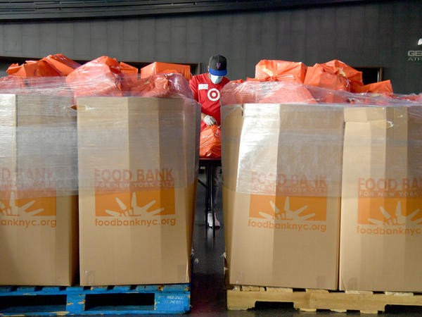 New Yorkers in need receive free produce, dry goods and meat at a Food Bank For New York City distribution event in July. Hunger is one of the most urgent — yet hidden — crises facing the nation.