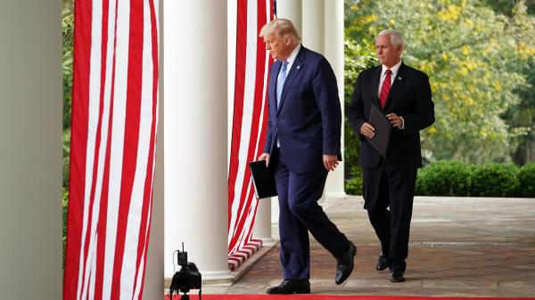 President Trump and Vice President Pence make their way to the Rose Garden at the White House on Monday to speak about coronavirus testing.