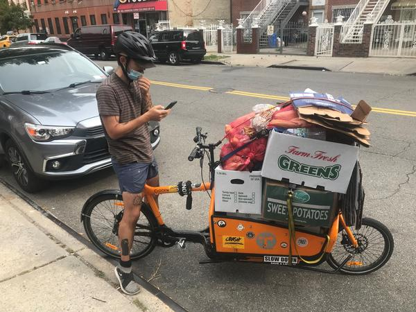 Volunteer Thadeaus Umpster with the anarchist collective In Our Hearts delivering donated produce to community fridges in the Bed Stuy section of Brooklyn.