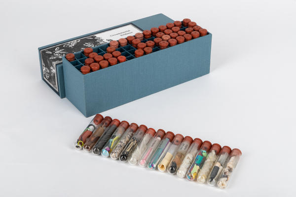 Some artist's books look like actual books, others might be a mason jar, a suitcase, or in artist Geo Rutherford's case, a box of vials filled with Great Lakes beach debris.