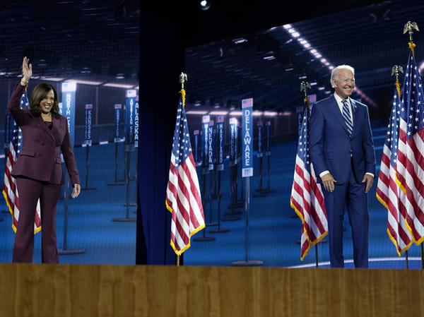 Sen. Kamala Harris stands with former Vice President Joe Biden after speaking last month during the Democratic National Convention.