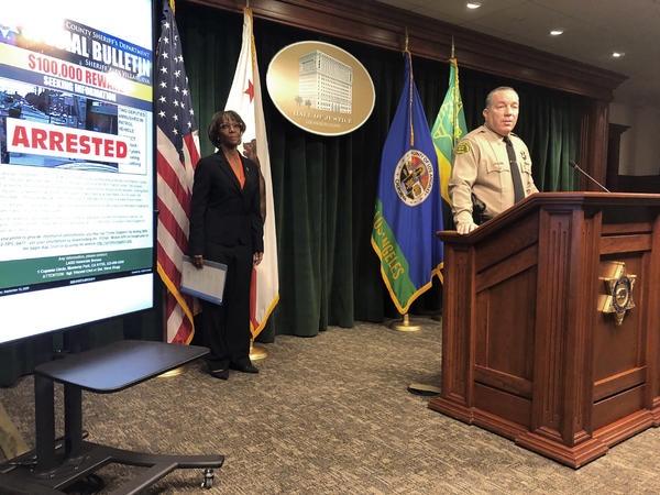 Los Angeles County Sheriff Alex Villanueva, right, and District Attorney Jackie Lacey, at a news conference on Wednesday announce the arrest of a man in connection with the shooting of two Los Angeles County sheriff's deputies.