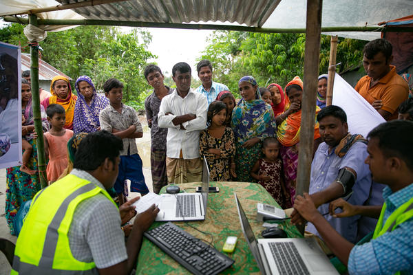 Patients line up for remote health consultation sessions on a remote island near Rangpur, Bangladesh.