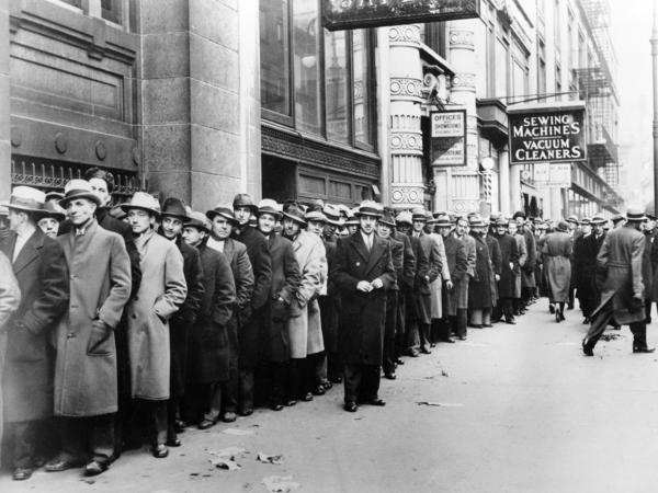 Unemployed people wait outside the state Labor Bureau in New York City in 1933. The current economic crisis has drawn comparisons to the Great Depression, but experts say this downturn should be shorter.