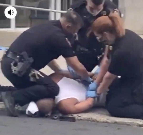 A screenshot from a cellphone video appears to show a police officer pressing his knee into a man's neck, in Allentown, Pa.