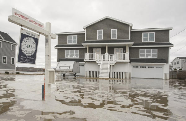 Floodwaters surround a newly constructed house for sale in Maine in 2018. Realtor.com added flood risk information to the more than 100 million listings on its site.