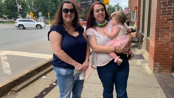 Grandmother Cindy Carroll, daughter Lauren Harrah and 11-month-old granddaughter Austin are headed to a local antique store in the historic district of Waxhaw, N.C. Carroll and Harrah aren't totally sold on President Trump, but they will vote for him over Joe Biden.
