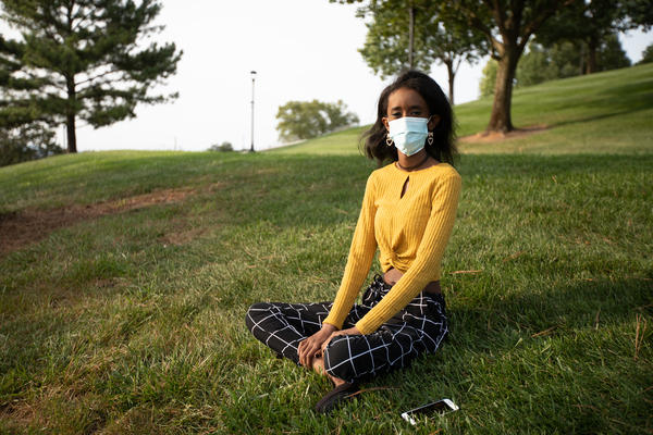 Huda Mohamed, a student at James Madison University in Harrisonburg, Va., has an immunodeficiency. She decided to take extra precautions by using Virginia's COVIDWISE app, which alerts users who may have been exposed to the coronavirus. Such apps are only available in a few states.