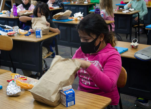 Students at Richard O. Jacobson Elementary School in Belmond, Iowa, unpack their lunches in their classroom, where they eat now because of pandemic social distancing requirements.