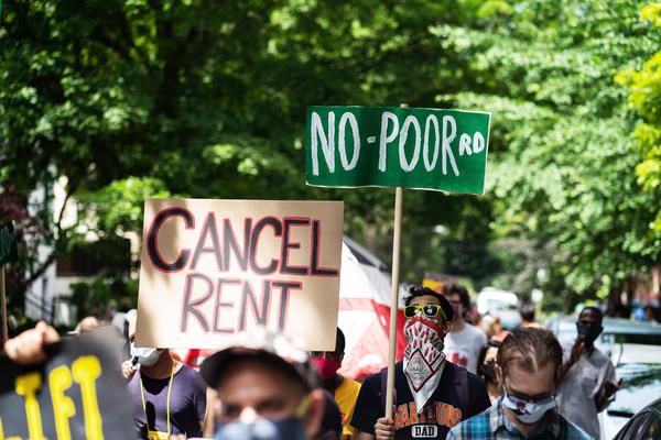Demonstrators march in Chicago's Old Town neighborhood in June to demand a lifting of the Illinois rent control ban and a cancellation of rent and mortgage payments. The pandemic's financial pressures are causing many Americans to struggle with rent payments.
