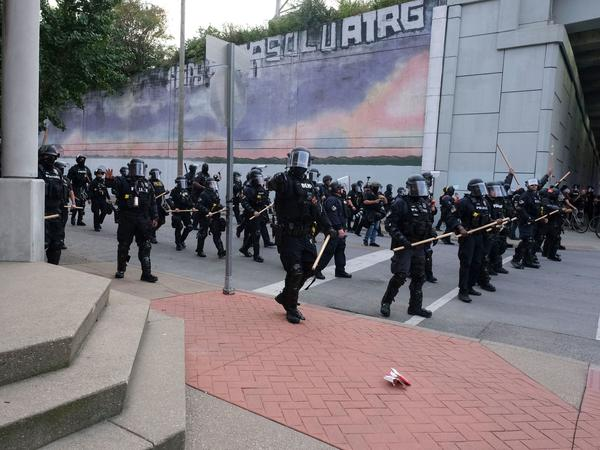A police line approaches demonstrators in downtown Louisville, Ky., last week during protests over the lack of criminal charges in the police killing of Breonna Taylor and the result of a grand jury inquiry.