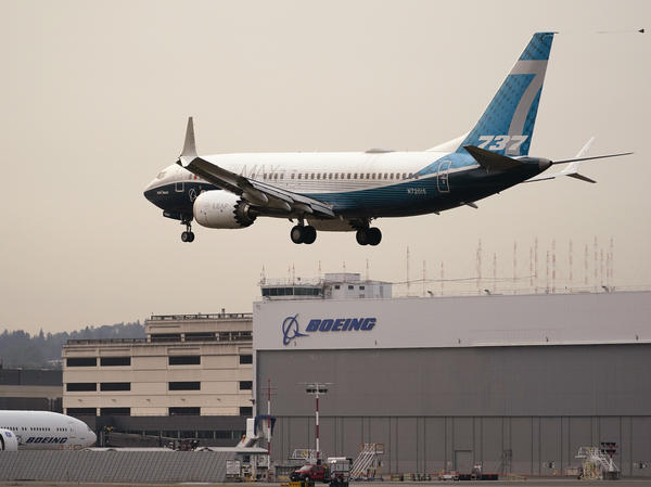 A Boeing 737 MAX jet, piloted by Federal Aviation Administration (FAA) chief Steve Dickson, prepares to land at Boeing Field following a test flight on Wednesday.