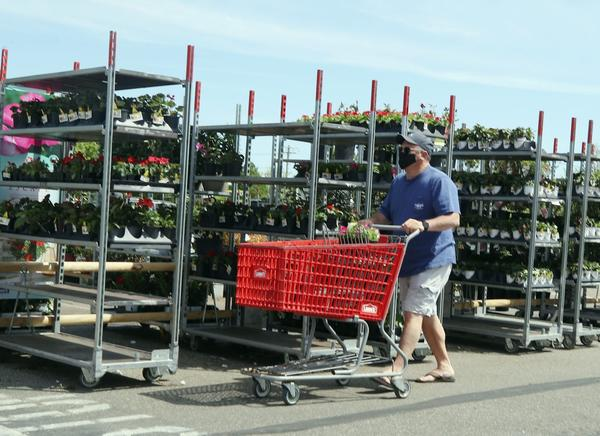 Shoppers stroll through Lowe's home-improvement store in Farmingdale, New York.