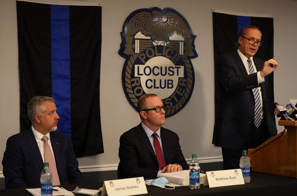 Attorney Michael Schiano, who is among those representing the seven Rochester Police officers who were suspended in the Daniel Prude case, talks to the media Thursday at the Locust Club police union headquarters.