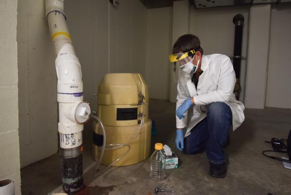 UNC Charlotte researcher Kevin Lambirth has been outfitting sewer and wastewater pipes underneath the univerity's dorms with special sampling equipment. The samples will be tested for the coronavirus.