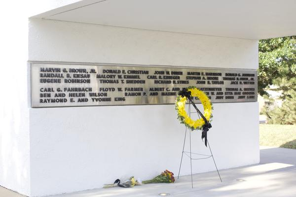 A wreath stands in front of the Memorial 70 sculpture on the WSU campus.