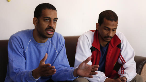 "Alexanda Kotey (left) and El Shafee Elsheikh, who were allegedly among four British jihadis who made up a brutal Islamic State cell dubbed ""The Beatles,"" speak during an interview with The Associated Press at a security center in Kobani, Syria, in March 2018."
