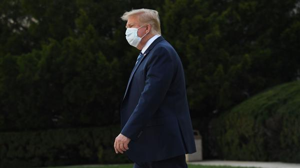 President Trump leaves Walter Reed National Military Medical Center in Bethesda, Md., on Monday. He announced Tuesday he was pausing negotiations on a coronavirus relief package.