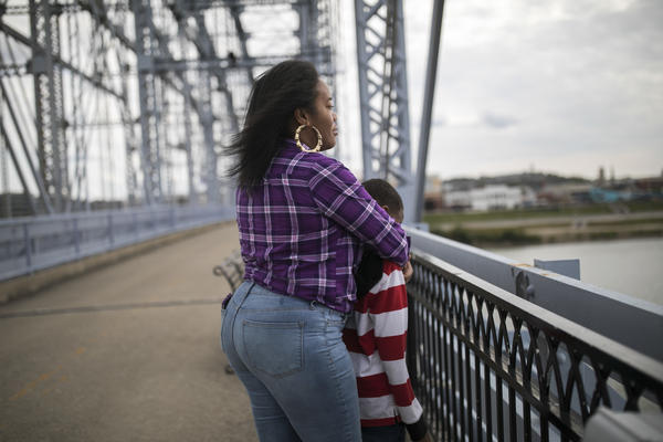 Freda and her 9-year-old son visit the Purple People Bridge in Cincinnati. She and her five children have been living in the front room of a friend's apartment, sleeping on pads of bunched-up comforters.