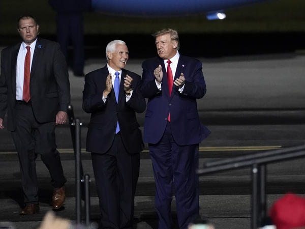 Vice President Mike Pence and President Trump at a campaign rally at Newport News, Va., on Sept. 25, a week before Trump was hospitalized with COVID-19.
