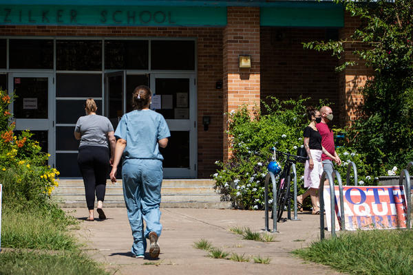 Voters walk into Zilker Elementary in Austin during the primary runoff elections on July 14.
