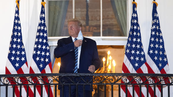 President Trump is seen removing his mask upon his return to the White House from Walter Reed National Military Medical Center on Monday, days after he tested positive for the coronavirus.