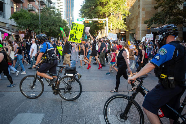 Protesters march near City Hall during a Black Lives Matter rally in June.