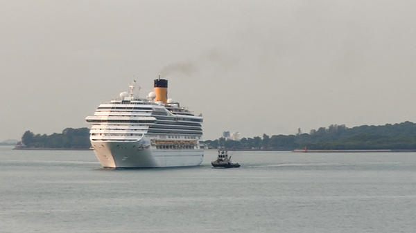 A cruise ship is shown here approaching a port in Singapore in March. Singapore plans to launch cruises with no destinations next month.