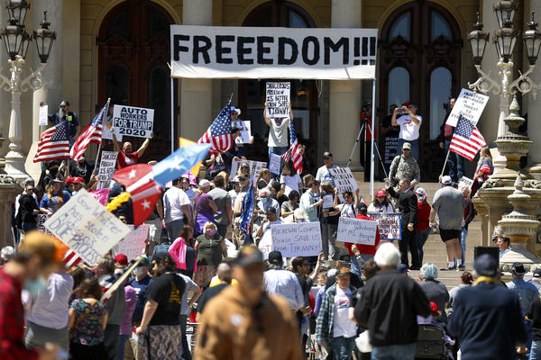 People protest at the state Capitol during a rally in Lansing, Mich., in May against Gov. Gretchen Whitmer's stay-at-home order.