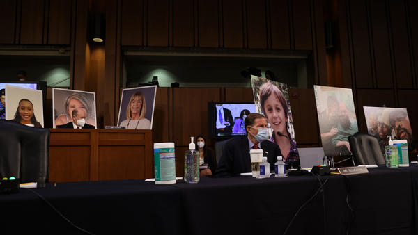 Democrats on the Senate Judiciary Committee display photos of people who have been impacted by the Affordable Care Act, as the lawmakers argue that confirming Amy Coney Barrett to the Supreme Court would be detrimental to health care.