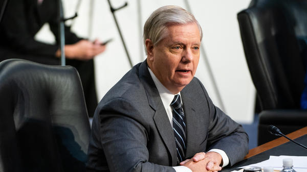 Senate Judiciary Chairman Sen. Lindsey Graham, R-S.C., speaks on the first day of Amy Coney Barrett's Supreme Court confirmation hearing on Capitol Hill on Monday. Graham defended the Republican effort to move swiftly on Barrett's confirmation.