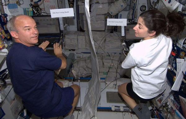 NASA astronauts Jeff Williams and Nicole Stott vote from space via email.