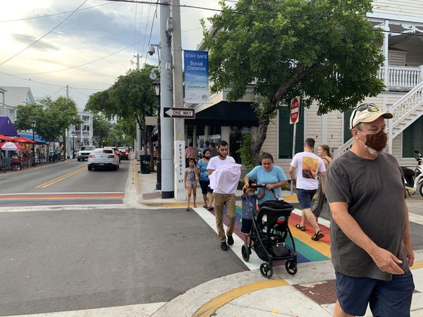 Despite messaging from street poles, Duval Street sidewalks have been crowded with some people wearing masks — and some not.