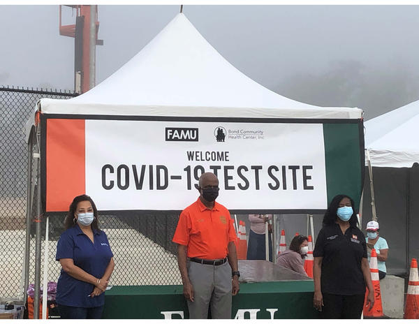 (From left) Bond CEO Dr. Temple Robinson, FAMU President Larry Robinson, Ph.D., and Cynthia Harris, Ph.D., director of the FAMU Institute of Public Health,  at the opening of the COVID-19 testing site.