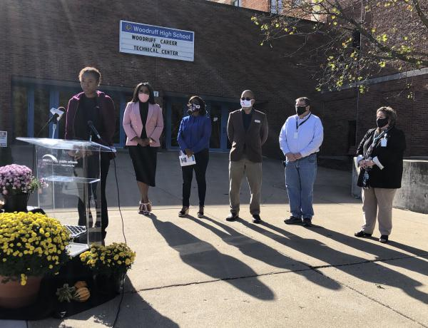 Kianna Pittman, left, shares her experience with the Woodruff Career and Technical Center during a Tuesday news conference announcing a $670,000 grant award for Peoria Public Schools' youth employment programs.